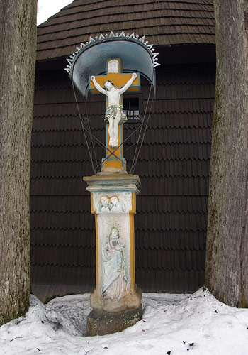 A shrine by the wall of the church in Jurgów