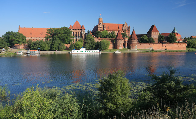 The Malbork Castle from the other side of the Nogat river