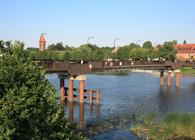The pedestrian bridge over the Nogat river in Malbork