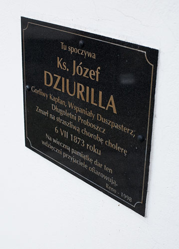 A plaque on the wall of the church in Krempachy, commemorating Józef Dziurilla, a priest who died during a cholera epidemic in 1873