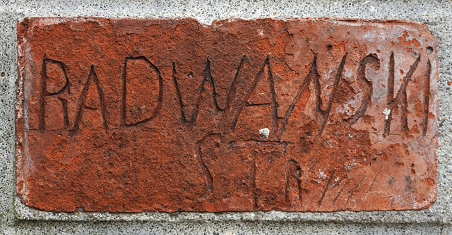 Signatures of Austro-Hungarian soldiers on a brick wall in Fort Lasówka