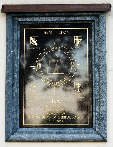 St. Giles' church in Giebułtów: a plaque commemorating the 400th anniversary of church consecration (1604-2004)