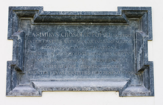 An epitaph (1872) on the wlal of the church in Ruszcza