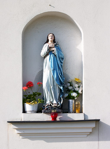 Holy Mary on the wall of the church in Skawina