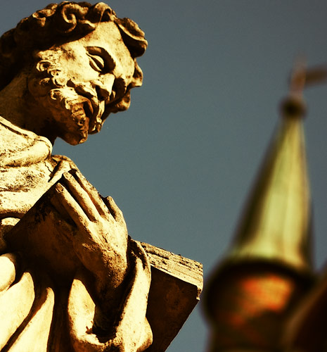 A statue of St. Jude the Apostle in front of the church in Skawina