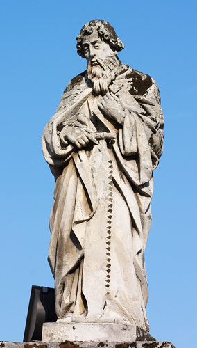 A statue of St. Simon the Apostle in front of the church in Skawina