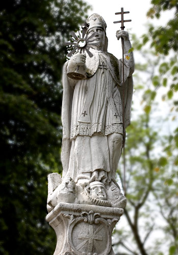 A statue of St. Norbert in front of the church in Hebdów