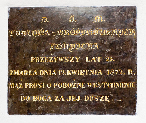 An old tomb plaque inside the church in Chotel Czerwony