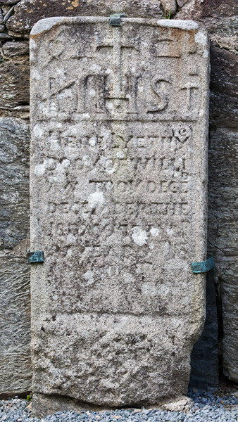 An old tombstone inside the cathedral in Glendalough