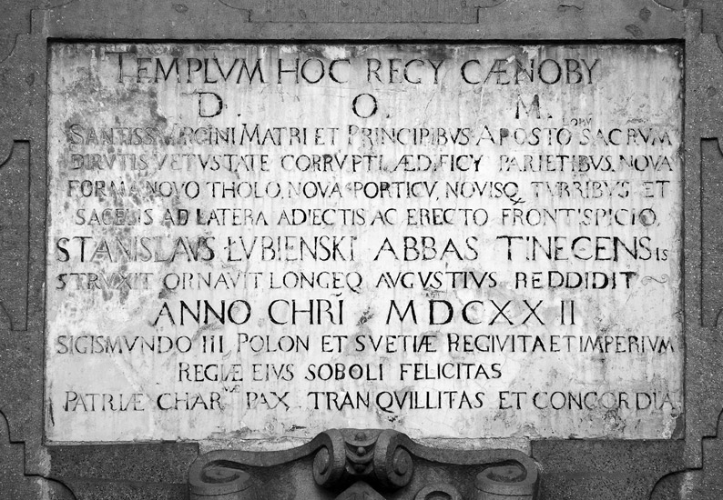 A memorial plaque on the facade of the abbey church in Tyniec, dated 1622