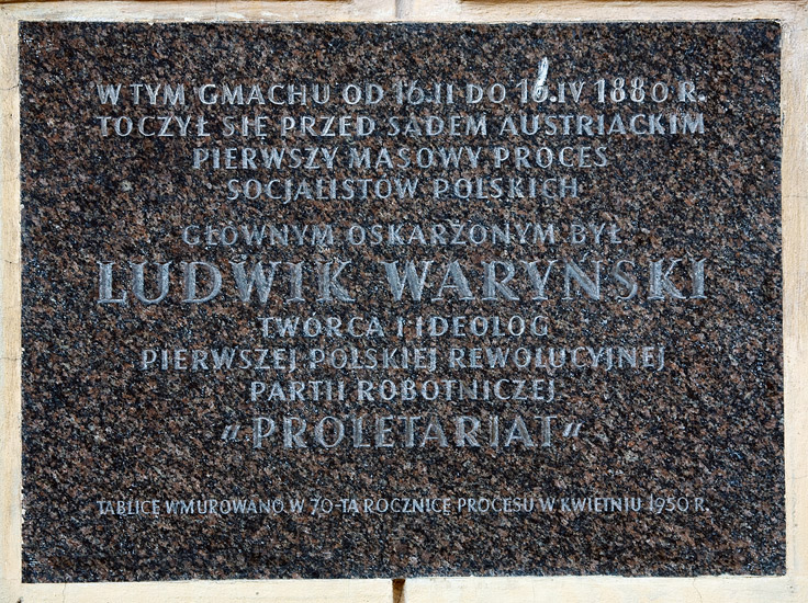 A memorial plaque on a wall of a building on Senacka Street in Kraków