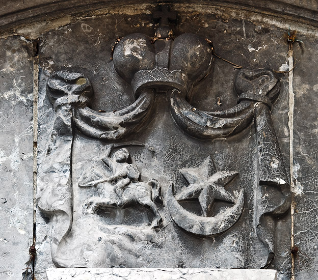 Coat of arms on the church in Morawica