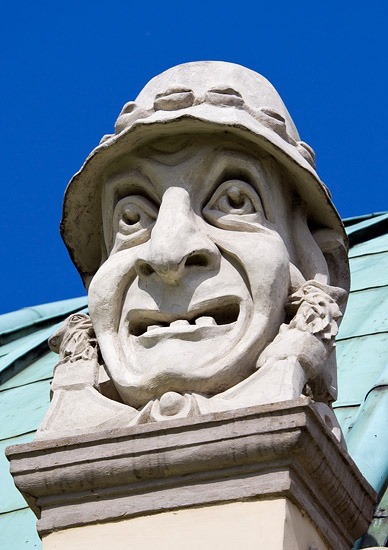 A stone mascaron from the roof of the Słowacki Theatre in Kraków