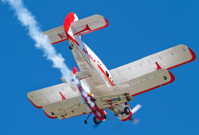 7th Air Show in Kraków: Jurgis Kairys flying just below an An-2