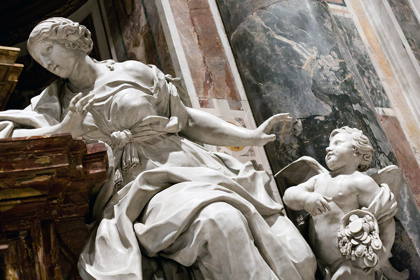 The statue of Unselfishness by Gaspare Sibilia, the monument to Pope Benedict XIV, St. Peter's Basilica in Rome