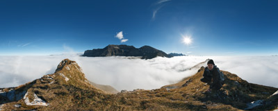 Above the sea of clouds on the summit of Axalphorn (2321 m) in the Swiss Alps.  Click to view this panorama in new fullscreen window