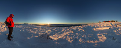 On the summit of Babia Góra (1725 m): sun rising behind the Tatra Mountains.  Click to view this panorama in new fullscreen window