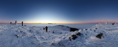 The sun setting over the sea of clouds watched from the summit of Babia Góra (1725 m).  Click to view this panorama in new fullscreen window