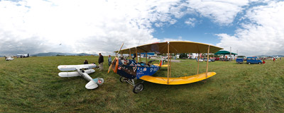 6th International Air Show in Bielsko-Biała: the 75% replica of a Curtiss Jenny WW1-era biplane.  Click to view this panorama in new fullscreen window