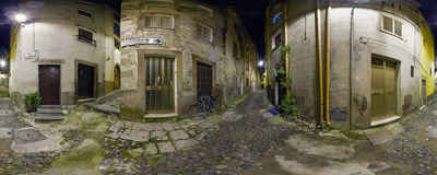 A narrow cobblestone street in the medieval part of Bosa, Sardinia, Italy.  Click to view this panorama in new fullscreen window