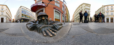 Čumil peeking from a manhole at a street crossing in Bratislava Old Town.  Click to view this panorama in new fullscreen window