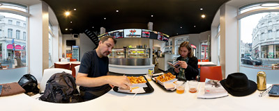 Stuffing ourselves in 't Brugsch Friethuys fast food joint at the corner of Geldmundstraat and Sint-Jakobsstraat in Bruges, Belgium.  Click to view this panorama in new fullscreen window