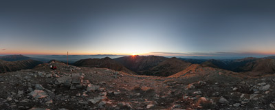 Watching the setting sun on the summit of Bystrá (2248 m), the highest peak of the Western Tatra Mountains.  Click to view this panorama in new fullscreen window
