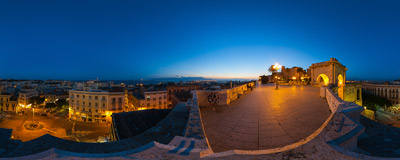 The night view of Cagliari, the capital city of Sardinia, from the 19th-century Bastion of Saint Remy.  Click to view this panorama in new fullscreen window