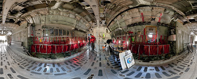Inside the cargo compartment of a Belgian Air Force's C-130 Hercules transport aircraft during the Czech International Air Fest 2010 at the Hradec Králové airport.  Click to view this panorama in new fullscreen window