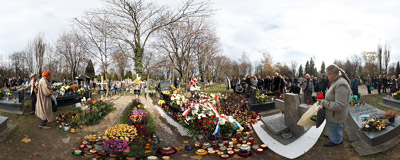 All Saints' Day at the Walk of Honour part of the Rakowice Cemetery in Kraków, by the fresh graves of men who died in the Smoleńsk disaster.  Click to view this panorama in new fullscreen window