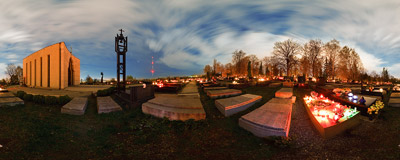 Salwator cemetery in Kraków on the eve of All Saints' Day: candles burning on the grave of Stanisław Lem, a famous SF writer.  Click to view this panorama in new fullscreen window