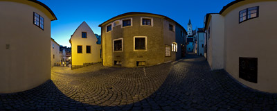 The narrow Kostelní Street in Český Krumlov with the slim Baroque tower of St. Vitus' church.  Click to view this panorama in new fullscreen window