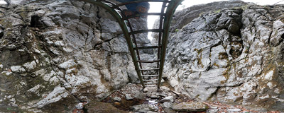 A tall metal ladder allows tourists to make their way through the narrow gorge forming the upper part of the Prosiecka Valley in the Chočské vrchy mountain range.  Click to view this panorama in new fullscreen window