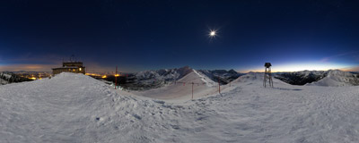 On the moonlit summit of Kasprowy Wierch (1987 m) in the Tatra Mountains.  Click to view this panorama in new fullscreen window