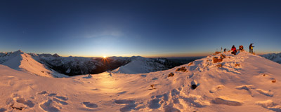Watching the setting sun on the summit of Kasprowy Wierch (1987 m) in the Tatra Mountains.  Click to view this panorama in new fullscreen window