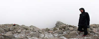 Surrounded by clouds on the summit of Kościelec (2155 m) in the Polish Tatra Mountains.  Click to view this panorama in new fullscreen window