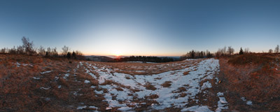 Sun rising above the mountains as seen from Koskowa Góra (866 m) in the Beskid Średni range.  Click to view this panorama in new fullscreen window