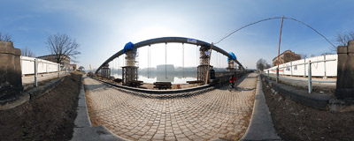 This 145-metre steel span is the main construction element of a new footbridge that is being built across the Vistula river in Kraków.  Click to view this panorama in new fullscreen window