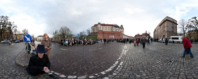 People of Kraków take part in the Holy Mass held in remembrance of Polish President Lech Kaczyński and other people who died this morning in a plane crash in Russia.  Click to view this panorama in new fullscreen window