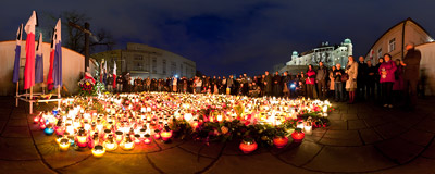 People of Kraków light candles in front of the Katyn Cross in remembrance of Polish President Lech Kaczyński and other people who died this morning in a plane crash in Russia.  Click to view this panorama in new fullscreen window