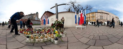 First candles start to appear in front of the Katyn Cross in remembrance of Polish President Lech Kaczyński and other people who died this morning in a plane crash in Russia.  Click to view this panorama in new fullscreen window
