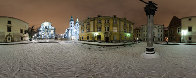 St. Mary Magdalen Square in Kraków with Piotr Skarga's statue and St. Peter & St. Paul's  and St. Andrew's churches in the background.  Click to view this panorama in new fullscreen window