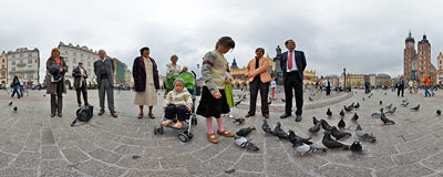 Feeding the pigeons in the Kraków Main Square.  Click to view this panorama in new fullscreen window