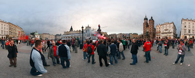 Fans of the Wisła Kraków football team are celebrating the 2009 league championship on the Main Square.  Click to view this panorama in new fullscreen window