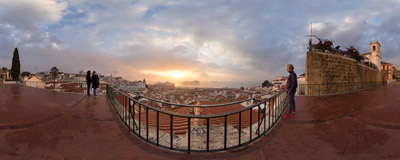 A foggy sunrise watched from the Miradouro das Portas do Sol in Alfama, the oldest district of Lisbon, Portugal.  Click to view this panorama in new fullscreen window