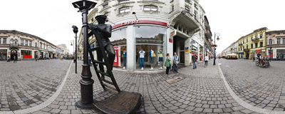 The statue of the Lamp Man on Piotrkowska Street in Łódź, part of the open-air Gallery of Famous Łódź Citizens.  Click to view this panorama in new fullscreen window