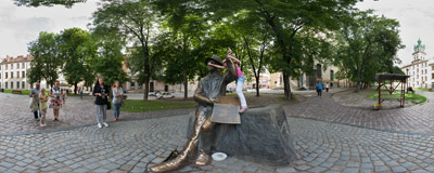 The 2006 statue of Nikifor (1895–1968), a Lemko primitivist painter, near the Dominican church in Lviv, Ukraine.  Click to view this panorama in new fullscreen window