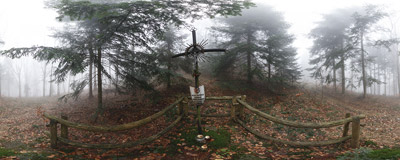 A symbolic grave of Polish partisans on the slopes of Łysina in the Beskid Średni mountain range.  Click to view this panorama in new fullscreen window