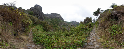 On the Caminho Real ('Royal Path') trail below the walls of the Pico Grande massif in the mountains of Madeira.  Click to view this panorama in new fullscreen window