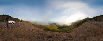 A play lof light and clouds watched from the ER 110 road between Porto Moniz and the Paúl da Serra plateau in Madeira.  Click to view this panorama in new fullscreen window